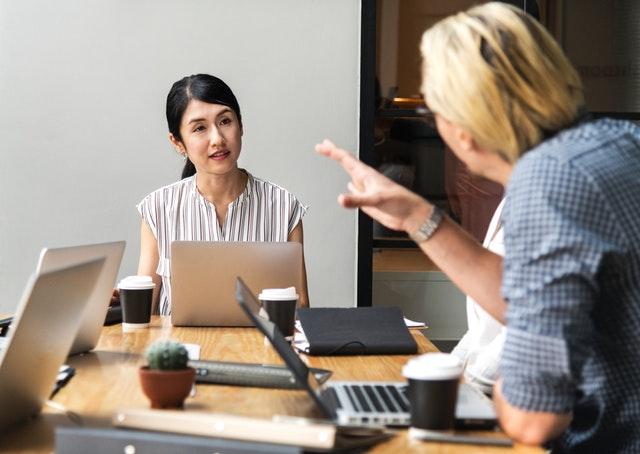 women listening with laptop