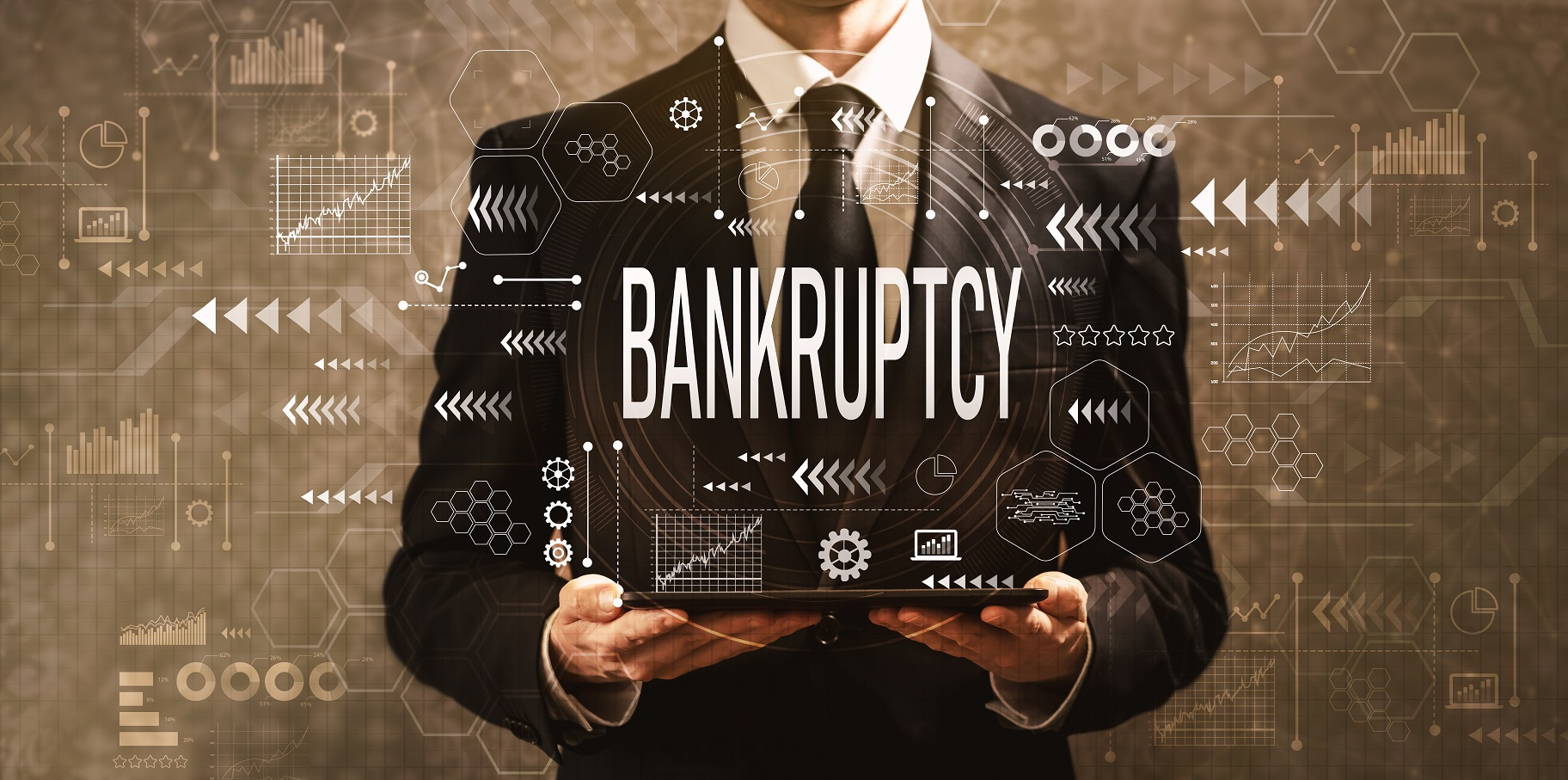 bankruptcy man in suit holding tablet